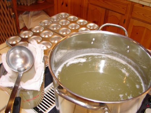 The tallow is all melted and ready to portion out into the muffin tins.