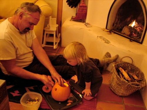 Papa and Isla work on Fred, our Jack-O-Lantern.