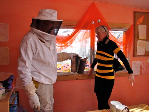 The beekeeper smokes a worker bee at the Waldorf school to encourage her to gorge on honey.